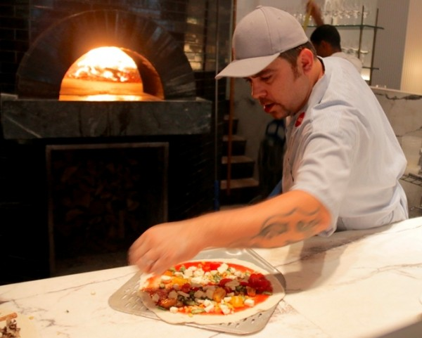 Salvatore Olivella shares flavor tips while making our pizzas at Marta